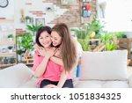 daughter give her mother hug... | Shutterstock . vector #1051834325