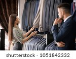 female shop assistant helping... | Shutterstock . vector #1051842332