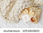 wooden tray with cup of tea ... | Shutterstock . vector #1051843832