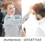 business colleagues to show... | Shutterstock . vector #1051877165