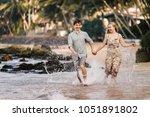 happy men and women are walking ... | Shutterstock . vector #1051891802