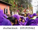 Small photo of Antigua, Guatemala: March 18 2018: Altar boy in front of a float with Christ and a cross at the procession of San Bartolome de Becerra in 1a Avenida
