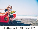 young hipster girl sitting on... | Shutterstock . vector #1051950482