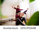 young cheerful father... | Shutterstock . vector #1051952648