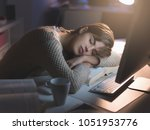 tired young woman sleeping on... | Shutterstock . vector #1051953776