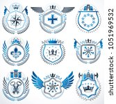 heraldic emblems with wings... | Shutterstock .eps vector #1051969532