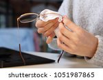 cleaning glasses. the woman... | Shutterstock . vector #1051987865
