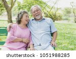 asian healthy senior couple... | Shutterstock . vector #1051988285