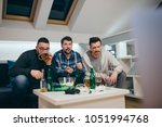 group of friends watching sport ... | Shutterstock . vector #1051994768