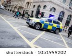 London, United Kingdom, 17th March 2018:- A police car blocking a road at the Stand Up to Racism march through central London - stock photo