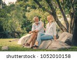 senior couple smiling and... | Shutterstock . vector #1052010158