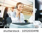 smiling agent woman with...   Shutterstock . vector #1052033498