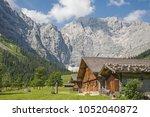 idyllic huts on the alpine... | Shutterstock . vector #1052040872