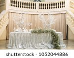 long dinner table decorated... | Shutterstock . vector #1052044886