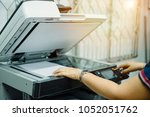 businesswoman put documents on... | Shutterstock . vector #1052051762
