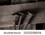 closeup of three rusty nails on ... | Shutterstock . vector #1052058056