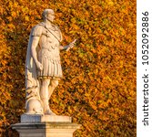 sculpture in a park in autumn | Shutterstock . vector #1052092886