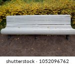 white bench of wood in the park.... | Shutterstock . vector #1052096762