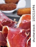 closeup of a some spanish tamas as serrano ham and croquettes - stock photo