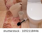 white counting bucket toilet... | Shutterstock . vector #1052118446