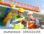 male architect and engineer... | Shutterstock . vector #1052121155