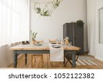 cozy interior of kitchen with... | Shutterstock . vector #1052122382