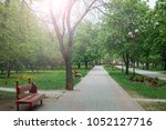 alley in the spring park.... | Shutterstock . vector #1052127716