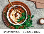 mexican food. beans. a bowl of... | Shutterstock . vector #1052131832