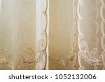 curtains in the home interior.... | Shutterstock . vector #1052132006