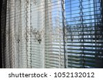 curtains in the home interior.... | Shutterstock . vector #1052132012