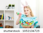 teenage girl holding easter eggs | Shutterstock . vector #1052136725