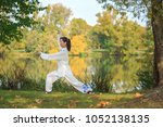 Young Woman Doing A Taichi Or...