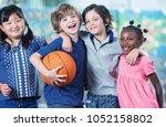 happy multi ethnic elementary... | Shutterstock . vector #1052158802