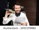 male radio broadcaster talking... | Shutterstock . vector #1052159882