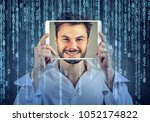 happy man holding tablet with... | Shutterstock . vector #1052174822