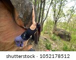 female climber with boulder... | Shutterstock . vector #1052178512