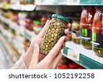 buyer hands with a can of... | Shutterstock . vector #1052192258