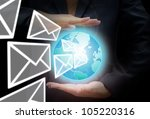 Business intelligent concept, businessman holding the world with email isolated on black. - stock photo