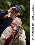 Elderly Tourists With Camera...