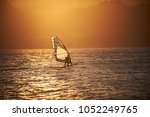 sportman windsurfer on the sea... | Shutterstock . vector #1052249765