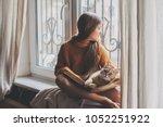 child in warm woolen sweater... | Shutterstock . vector #1052251922
