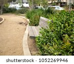 park bench in a santa barbara ... | Shutterstock . vector #1052269946