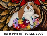 close up toy dog with raised... | Shutterstock . vector #1052271908