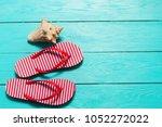 summer flip flops with shell...   Shutterstock . vector #1052272022