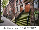 a row of brownstone buildings... | Shutterstock . vector #1052273342