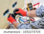 electrician technician at work... | Shutterstock . vector #1052273735