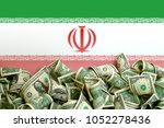 iran flag with us dollars | Shutterstock . vector #1052278436