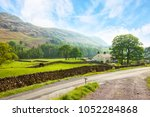 scenic view of a valley with a  ... | Shutterstock . vector #1052284868