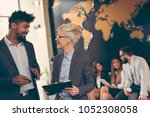 businessman and businesswoman... | Shutterstock . vector #1052308058