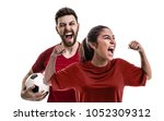 young couple fan in red uniform ... | Shutterstock . vector #1052309312